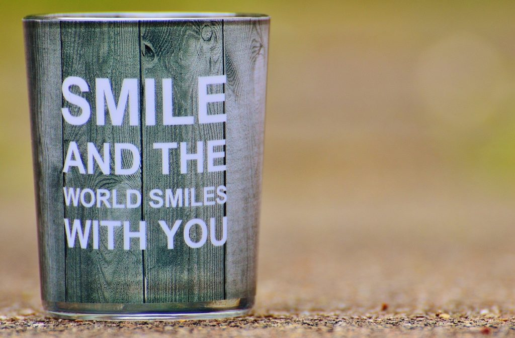 citation smile and the world smiles with you